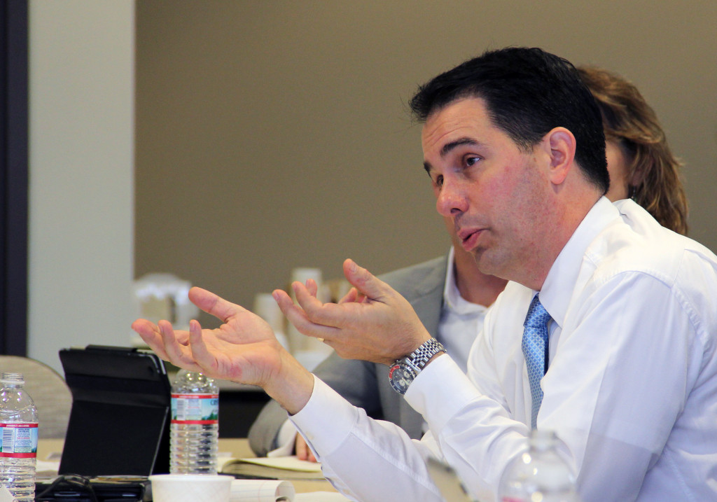 Wisconsin Governor Scott Walker speaks at a roundtable on entrepreneurship today at University Research Park in Madison, Wis.