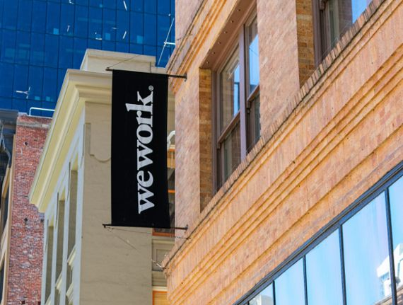 WeWork moves to curb costs, but bond prices tumble